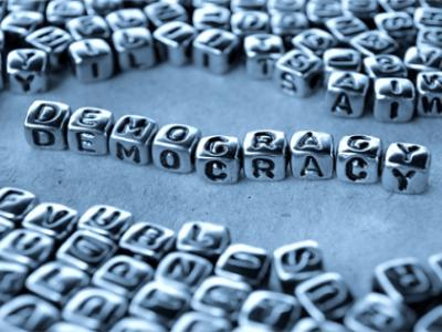 Asymmetric Democracy and Governing